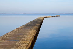 Long wooden pier on big lake Stock Images