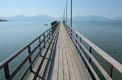 Long wooden pier at Chiemsee lake in Germany Royalty Free Stock Photos