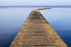 Long wooden pier on lake Stock Photo