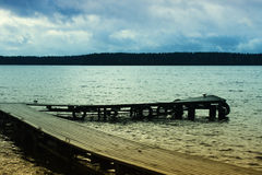 Long Wooden Pier. Lake at the evening, long wooden pier Royalty Free Stock Images
