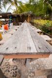 Long wooden table. Stock Photos