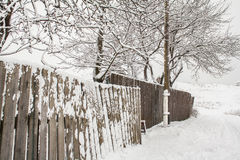 Long wooden winter fence and electric pole in good perspective Stock Photography