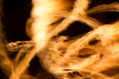 Long yellow flames. Abstract yellow firestorm in the dark night Royalty Free Stock Image