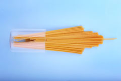 Free Long Yellow Pasta. Pasta Noodles On A Blue Background. Spaghetti In A Glass. Natural Ingredients For Healthy Dishes. Stock Photos - 97749383