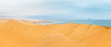 Long yellow sand dune of Kalahari desert and Atlantic ocean shor royalty free stock photos