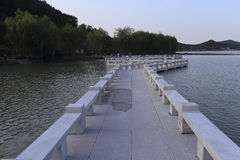 A long zigzag bridge. Zigzag bridge across the lake Stock Photography