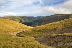 Long zigzag path between hills, Fagaras mountains, Romania Royalty Free Stock Image