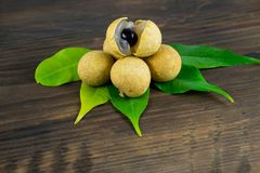 Longan. Fresh longan fruits. Longan. Fresh longan fruits isolated on wooden board Royalty Free Stock Photos