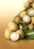 Longan. Fruit (longan) on orange background Royalty Free Stock Images