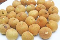 Longan fruit on white plate stock photo