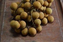 Longan fruit on the wood Stock Image