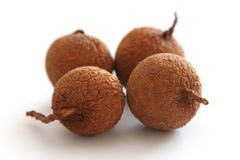 Longan fruits. Four longan fruits on white background, shallow DOF Royalty Free Stock Images