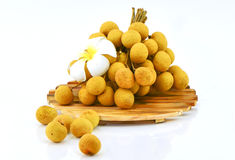 Longan fruits and chopping block on white background Stock Images