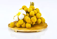 Longan fruits and chopping block on white background Stock Photography