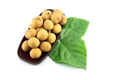 Longan placed in bamboo. Stock Photos