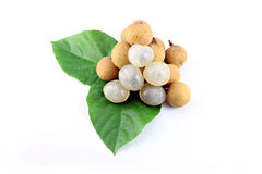 Longan resting on leaves. Stock Photo
