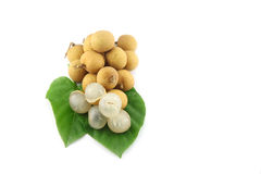 Longan resting on leaves. Royalty Free Stock Images