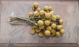 Longan Thai fruit on the wood Royalty Free Stock Image