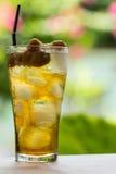Longan water. Longan, sweet fresh water in the glass royalty free stock image