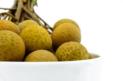 Longan in a white cup. Royalty Free Stock Images