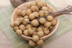 Longan on wood bowl. Close up of Longan on wood bowl Royalty Free Stock Photo
