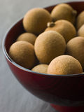 Longan in Wooden Bowl Stock Photography