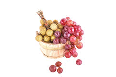 Longans and red grapes in a rustic wooden bucket Royalty Free Stock Photo