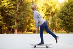 Longboard girl on street at beautiful summer evening, long board. stock photography