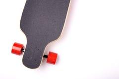 Longboard isolated on white background. Longboard with red wheels isolated on white background Royalty Free Stock Photography