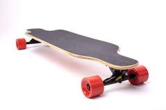 Longboard isolated on white background. Longboard with red wheels isolated on white background Royalty Free Stock Photo