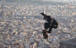 Longboard jump with barcelona views on back Stock Photos