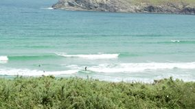 Longboard Surfer at Pantin Galicia Spain. Summer. Riding the wave stock video