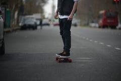 Longboard teenager Immagine Stock
