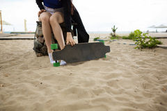Longboarder on the beach Stock Photos