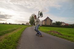 Longboarder down the hill royalty free stock photos