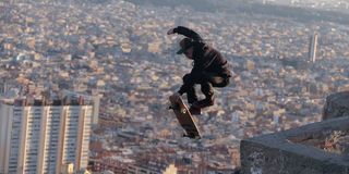 Longboarder flying over barcelona Royalty Free Stock Photography