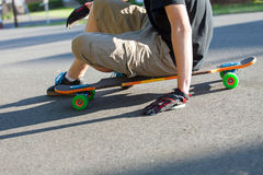 Longboarder Sitting Royalty Free Stock Image
