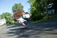 Longboarder Speeding Downhill Stock Photo
