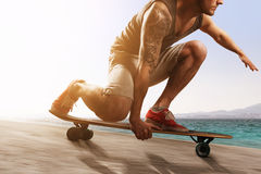 Longboarder. Sporty Man on a Longboard Stock Photography