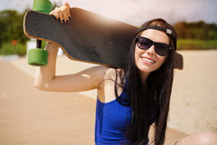 Longboarder in the sunshine Royalty Free Stock Images