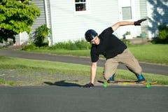 Longboarder Trick Slide Stock Image