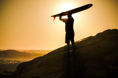 A longboarder watching the waves Stock Image