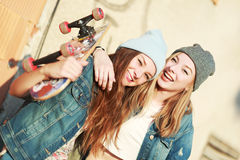Longboarding girl friends Royalty Free Stock Image