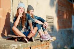 Longboarding girl friends Stock Image