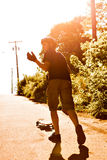 Longboarding Teen Silhouette Stock Photography