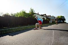 Longboarding Teens Royalty Free Stock Image