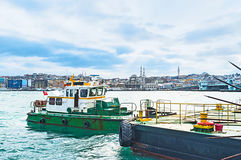 The longboat. The green longboat at pier next to the Galata Bridge, Istanbul, Turkey Stock Images