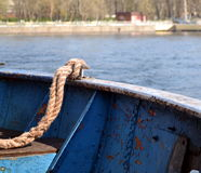 Longboat moorings. On the background of the river Stock Photo