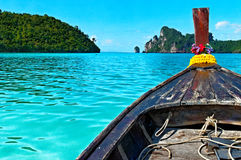 Longboat in Thailand. Traditional Asian long boat in blue sea, Loh Da Lum bay, Phi Phi Island, Thailand Stock Image