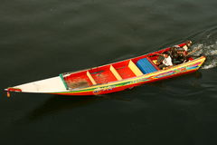 Longboat Thailand. Long boat travelling down the River Kwai in kanchaniburi Thailand Royalty Free Stock Image